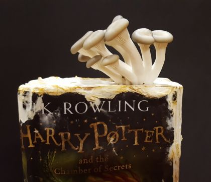 Oyster mushrooms degrading Harry Potter and the Chamber of Secrets - close up